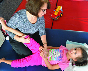 female elementrary student worlong with physical therapist - private special education, Passaic NJ