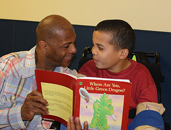 NJEDDA High School Teacher reading with male student at private special education school in Clifton NJ